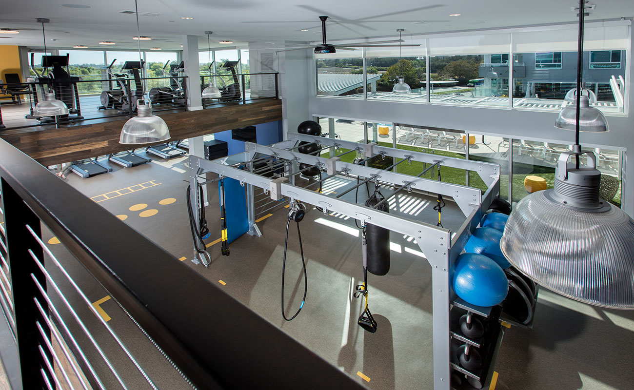 Irvine CA Apartments-The Royce Fitness Center with 2 Stories of Gym Equipment Including Cardio and Weight Machines